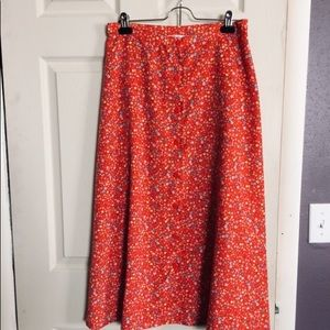 Long red floral skirt